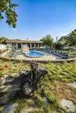 BULGAREVO, BULGARIA, AUGUST 09, 2016: cascade and swimming pool. In the eco complex bulgarevo surrounded by Lounge chairs Royalty Free Stock Image
