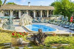 BULGAREVO, BULGARIA, AUGUST 09, 2016: cascade and swimming pool. In the eco complex bulgarevo surrounded by Lounge chairs Stock Photography