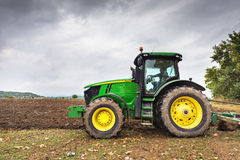 Bulgaria - August 22th,2015: Ploughing a field with John Deere. Karlovo, Bulgaria - August 22th, 2015: Ploughing a field with John Deere 6930 tractor. John Deere Stock Photo