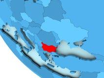 Bulgaria on blue political globe. Bulgaria highlighted in red on blue political globe. 3D illustration Royalty Free Stock Photos