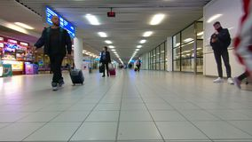 Time lapse of people in a rush in the airport. BULGARIA - DECEMBER 22, 2018 - Time lapse of people walking around the Sofia airport in Bulgaria stock video