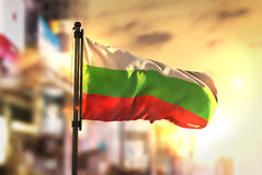 Bulgaria Flag Against City Blurred Background At Sunrise Backlight. Sky stock photo