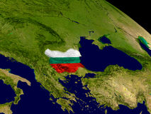 Bulgaria with flag on Earth. Map of Bulgaria with embedded flag on planet surface. 3D illustration. Elements of this image furnished by NASA Royalty Free Stock Photos