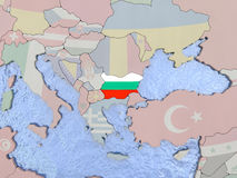 Bulgaria with flag on globe. Map of Bulgaria with national flag on political globe with realistic water. 3D illustration Stock Photo