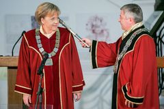 Bulgaria Merkel Doctor Honoris Title. Sofia, Bulgaria - October 11, 2010: German Chancellor Angela Merkels smiles as she receives the doctor honoris causa title stock images