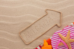 Bulgaria  pointer and beach accessories lying on the sand Stock Images