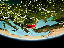 Bulgaria in red in the evening. Country of Bulgaria in red on planet Earth in the evening with visible border lines and city lights. 3D illustration. Elements of Royalty Free Stock Image
