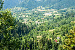 Bulgaria. Rhodopes. Houses in the valley Royalty Free Stock Photos