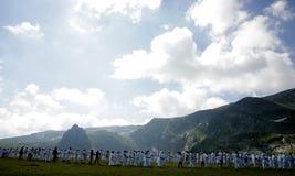 Bulgaria Rila Mountain White Brotherhood. Unidentified members of White Brotherhood perform a ritual dance called Paneurhythmy near Babreka (The Kidney) Lake Royalty Free Stock Photos