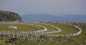 Bulgaria Rila Mountain White Brotherhood. Unidentified members of White Brotherhood perform a ritual dance called Paneurhythmy near Babreka (The Kidney) Lake Royalty Free Stock Photography