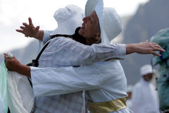 Bulgaria Rila Mountain White Brotherhood. Unidentified members of White Brotherhood embrace each-other after ending of a ritual dance called Paneurhythmy near Royalty Free Stock Photos