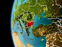Bulgaria from space in evening. Evening over Bulgaria as seen from space on planet Earth with visible border lines and city lights. 3D illustration. Elements of stock photos