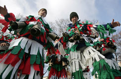 Bulgaria tradition Kukeri. Pernik, Bulgaria - January 26, 2008: Two boys in traditional masquerade costumes are seen at the the International Festival of the Royalty Free Stock Photography