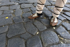 Bulgaria Traditional Sandals. Bulgarian traditional sandals on stone pavement street in old town of Plovdiv Stock Image