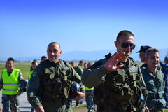 Bulgarian Air Force aviators greet audience. Air and ground demonstrations were shown in an air show on the occasion of the 102 anniversary of Bulgarian Air Stock Photos