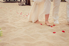 Bulgarian beach wedding. Bride and her father are walking. Beach wedding bride and her father are walking stock images