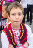 Bulgarian boy in national costume at Nestenar Games in the village of Bulgarians. Bulgaria is the only country in the world where barefoot people dance on red Stock Photo