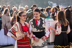 Bulgarian dancers in folk costumes getting ready for the round dance stock image