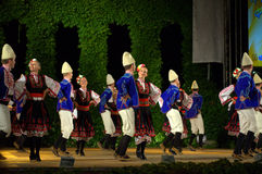 Bulgarian dancers at folklore festival stage Royalty Free Stock Photos