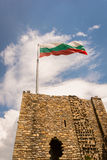 Bulgarian flag over gate in Veliko Tarnovo castle. Bulgarian flag over gate in the historic town of Veliko Tarnovo castle, Bulgaria Royalty Free Stock Photo
