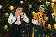 Bulgarian folklore. Christmas performance of bulgarian folklore formation in Mall Serdika -  24. 12. 2012, Sofia, Bulgaria Stock Photo