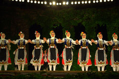Bulgarian folklore dancers at stage Stock Photos