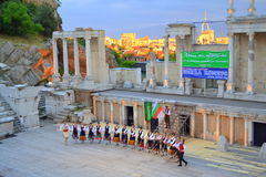Bulgarian folklore group,Plovdiv Amphitheater. Bulgarian folklore group dancing at ancient Roman Amphitheater  stage during the 3rd Balkan folklore festival and Royalty Free Stock Photos