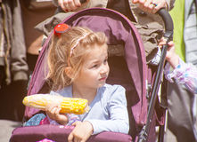 Bulgarian girl eating corn Stock Photo