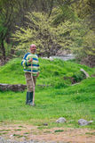 Bulgarian herdsman with bludgeon on field - 09-04-2016 - Bistrets, Bulgaria Royalty Free Stock Photography