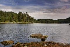 Bulgarian high mountain lake. Two stones on the beach of beautiful bulgarian lake Royalty Free Stock Photo
