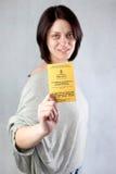 Uk work permission. Bulgarian immigrant holding uk work permission card for bulgarians and romanians royalty free stock image