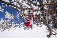 BULGARIAN MARTENITSA, Pizho and Penda. Bulgarian tradition is to meet the spring hanging martenitsa on a blossom tree Stock Photo