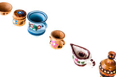 Bulgarian Mini tableware. A collection of colorful bulgarian miniature tableware isolated over a white background Royalty Free Stock Images