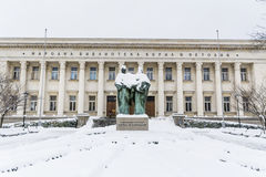 Bulgarian National Library and momument of Cyril and Methoduis. Bulgarian National Library in Sofia,Bulgaria in a winter snowy day Royalty Free Stock Photo