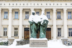Bulgarian National Library and momument of Cyril and Methoduis. Bulgarian National Library in Sofia,Bulgaria in a winter snowy day Royalty Free Stock Images
