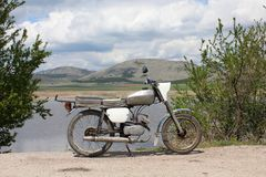 Bulgarian old motorcycle Balkan at Aldomirovsko Blato swamp. Dragoman is Bulgarian town very close to the western border of the country with Serbia. Through Royalty Free Stock Photo