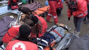 Bulgarian Red Cross Youth Paramedics volunteers stretcher 4k. Sofia, Bulgaria - 5 December 2018: Volunteer paramedics from Bulgarian Red Cross Youth provide stock footage