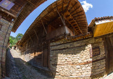 Bulgarian rural architecture: stone and wood Royalty Free Stock Image
