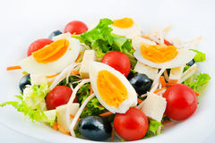 Bulgarian Salad. Fresh bulgarian salad made of baby tomatoes eggs olives carrot  fresh spring salad and vegetables Royalty Free Stock Image