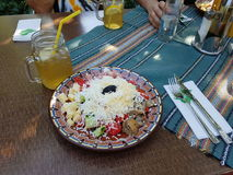 Bulgarian shepherd salad with a drink Royalty Free Stock Images