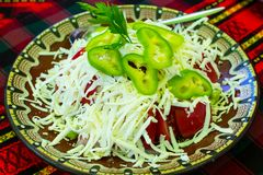 Bulgarian Shopsky Salad made of tomatoes, cucumbers and cheese Royalty Free Stock Images