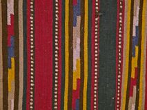 Bulgarian traditional folk carpet fabric with geometric motives and bright colors Royalty Free Stock Photo