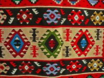 Bulgarian traditional folk carpet fabric with geometric motives and bright colors Stock Photos