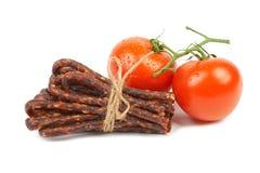 Bulgarian traditional sausage Bireni. Bulgarian traditional sausage Bireni, With Ripe red tomatoes. Isolated on white Royalty Free Stock Image