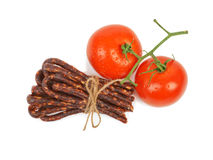 Bulgarian traditional sausage. Bireni, With Ripe red tomatoes. Isolated on white Royalty Free Stock Image