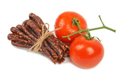 Bulgarian traditional sausage. Bireni, With Ripe red tomatoes. Isolated on white Royalty Free Stock Photography