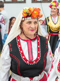 Bulgarian woman in national costume at the Nestinar Games. Bulgaria is the only country in the world where barefoot people dance on red-hot charcoal. The village Royalty Free Stock Photos