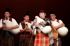 Bulgarians in folklore clothing bagpipes Stock Photo