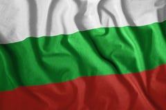 Bulgarische Flagge, die im Wind durchbrennt Teil einer Reihe Lizenzfreies Stockfoto