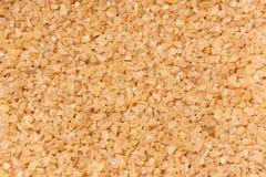 Bulghur grains - background. A background made of bulghur grains stock image